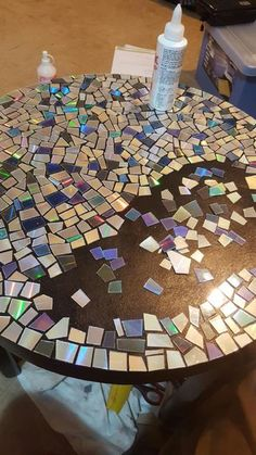 CD Mosaic Table is part of Cd diy CD Mosaic Table We were going to throw out a bunch of old CD& when I remembered we had this coffee table sitting on the back porch gathering dust Very happy wit - Cd Mosaic, Mosaic Crafts, Mosaic Projects, Diy Projects, Mosaic Mirrors, Mosaic Birdbath, Cd Diy, Home Crafts, Diy Home Decor