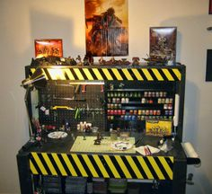 Tabletop miniatures gamer Bob Simpson built this awesome painting station to work on his Warhammer and Warhammer 40K miniatures.