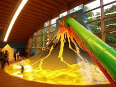 Placing a volcano in your #indoorplayground? A great addition to this attraction is a slide. Children can climb up the volcano and slide down . #slide #volcano
