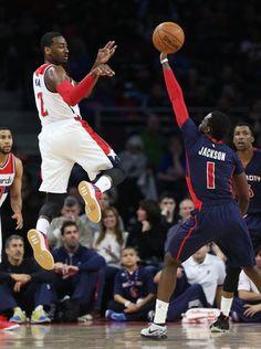 Detroit Pistons Reggie Jackson defends against the