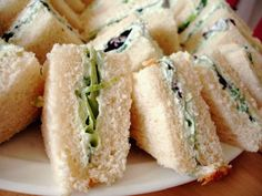 Vamp up your typical tea sandwiches; these Benedictine cheese sandwiches add scallions to the traditional cucumbers and cream cheese for a punch of flavor. Mini Sandwiches, Cucumber Tea Sandwiches, Finger Sandwiches, Tea Recipes, Cooking Recipes, Jai Faim, Simply Yummy, Derby Party, Sandwich Recipes