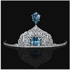 This aquamarine tiara belong to Princess Olga Paley who was the second wife of Grand Duke Paul Alexandrovich of Russia. It is probably dated from the late 19th century and appears to made of diamonds and a large emerald cut aquamarine