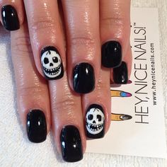 Hand painted skulls - reminds me of The Misfits logo
