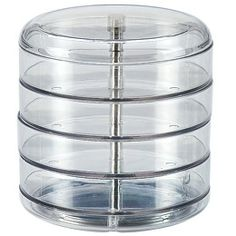 Going vertical with small office supplies on a small desk with a swivel container. Each container swivels out for compact storage solutions.