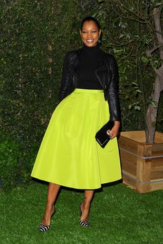 Love this pop of color!  Neon yellow skirt paired with black top leather jacket and zebra print pumps