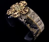 "THIS ASTONISHING ""CRYSTAL SAFARI"" NARROW CUFF WITH SWAROVSKI CRYSTALS WILL PUT YOU IN THE SPOTLIGHT."