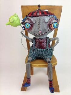 """Flim Flam Freddie 2014 15"""" x 8"""" x 7"""" Knitted Wire, Clay, Paint, Wood Chair can also be mounted to wall Reina Mia Brill"""