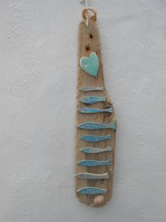 From Skellig Pottery driftwood found on a local beach with ceramic fish and heart.