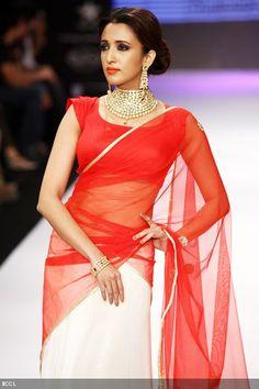 Model Iris Maity showcases a jewellery creation by designer group Laxmi Jewellers during the third season of India International Jewellery Week (IIJW) in Mumbai on August 19, 2012.