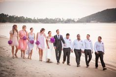 The bridal party walk at sunset - a perfectly captured shot by Khun Danai
