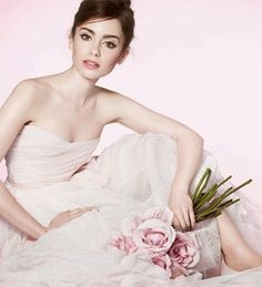 Lily Collins for her lancome photoshoot. I love how there's a ballerina feel to everything.