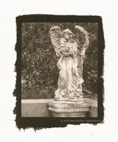"Graveyard Angel with Bunny Rabbit, Bonaventure Cemetery, Savannah, Georgia, Palladium Toned Kallitype  © 2018 Patty Hankins  An adorable graveyard angel holding a bunny rabbit  One of a kind print, matted in a single white mat to 11""X14"""