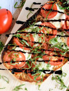 This Roasted Garlic Caprese Flatbread couldn't be easier to make since it uses a halved loaf of ciabatta bread. You can literally have dinner on the table in 10 minutes!