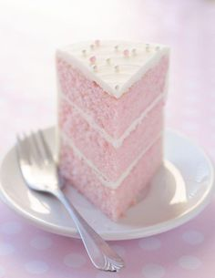 Pink Almond Party Cake. I have never seen a perfect slice of cake as this one. I just want to pick up that fork and dive right in to decadent goodness. Yum!