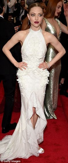 Angelic: Wearing white to the fashion bash were (L-R) Amanda Seyfried (in Givenchy), Diann...