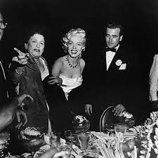 Louella Parsons, Marilyn Monroe and the matire d of the Ambassador Hotel at the Cinerama party at the Coconut Grove, c.