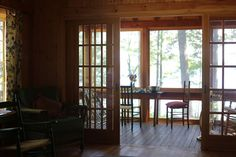 love those sliding french doors and the porch