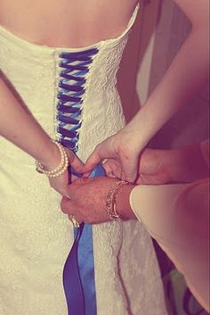 another way you can add color - if the dress has a lace up you can use blue instead of white.