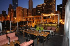 """Tavern at the Park (Tree House)   Loop Since we all know how temperamental Chicago's weather can be, it's nice that Tavern at the Park has indoor views from a glass atrium that's called """"Tree House."""" Views of South Michigan Ave and Millennium Park pair with the """"Stop! Tequila Thyme!"""" (which features a vanilla bean, thyme & cucumber-infused Maestro Dobel tequila served in a heated snifter over a rocks glass of boiling water!)"""