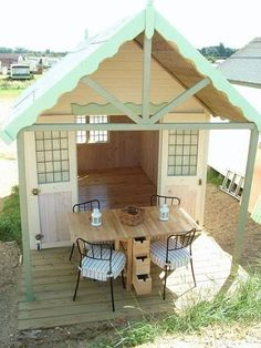 Photos courtesy of James Ward Beach Huts--- and that is the table I want from Ikea!!