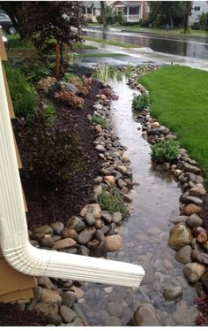 Dry creek bed... pretty when dry, but great for diverting excess rainwater when it pours...i want one in my yard!
