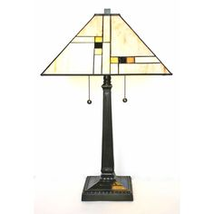 The subtle color scheme of this Tiffany-style table lamp adds an elegant and timeless atmosphere to your room. The gold shade, made of stained glass with hand-cut geometric designs, offers a soft glow