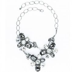 Three flowers necklace with strass. Whether you wear them for day or evening, a dusting of strass will turn the simplest of looks into something spectacular.