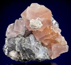 reddish-pink Fluorite cubes with Barite on Galena