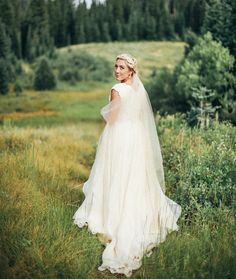 modest wedding dress with cap sleeves and a flowing skirt from alta moda (modest bridal gown)