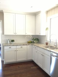 Granite similar to my house with the white cabinets with hardwood floor and white subway tile. Timeless look.TUESDAYS WITH DORIE