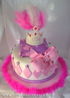 fancy nancy cake with big pink bow, princess crown, feathers and glitter