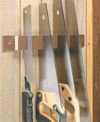 Tension hand saw holder