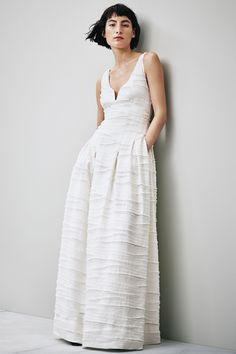This structured gown — made of textured fabric composed of organic linen, silk, and cotton — is a great fit for a summer wedding.H