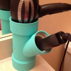 DIY idea Hair Dryer and Curing Iron Holder. using that PVC pipe stuff. I'd paint it a nice, matching color :)