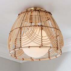This ceiling light, assembled by hand in our Richmond, Virginia production facility with solid brass hardware, is a perfect blend of Art Deco designs and a beachy vibe with the woven shade. Bringing a refined, beachy touch to any space. Due to the nature of working with a natural material no two will be exactly alike in color or pattern. Coastal Living Room, Ceiling Lights, Woven Shades, Light Shades, Ceiling, Entry Lighting, Rattan Light Fixture, Basket Lighting, Art Deco Living Room