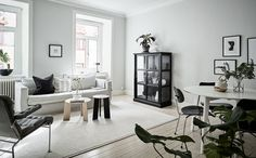 Stunning Scandinavian style interior   Bruno Mathsson Karin armchair   layered Scandinavian minimalism   Grey linen sofa   styling by Grey Deco   IKEA  Karlstad sofa with a Bemz Loose Fit cover in Graphite Brera Lino linen