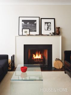 Cheap & Chic Mantel Makeover | House & HomeUse budget-friendly materials to create a new look.  This fireplace lacked cohesive style with the rest of the house. The owners opted for a creative — and economical — solution by constructing a new clean-line mantel out of MDF and painting it a crisp white. A black granite surround and hearth provides bold contrast.
