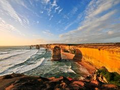 Eight towering limestone monoliths make up the Twelve Apostles that sit on Great Ocean Road in southeastern Australia.