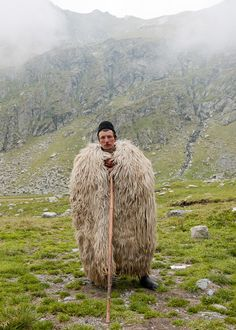 Shepherd in Romania -I should make a coat like this for my sheep herding brother.