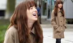 Dakota Johnson smiles as she films Fifty Shades Darker in the rain