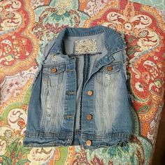 Crop denim jacket Very cute cropped denim jacket, he a light wash distressed look. Tag says medium but fits like a small. YMI Jackets & Coats Vests