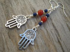 Hamsa Gemstone Earrings Carnelian & Lapis by Abundantearthworks  #hamsa #hamsaearrings #hamsajewelry #evileye #hindu #hinduearrings #yoga #yogaearrings #carnelian #lapislazuli #lapisearrings #carnelianearrings #abundantearthworks #gemstoneearrings #dangleearrings #boho #bohochic