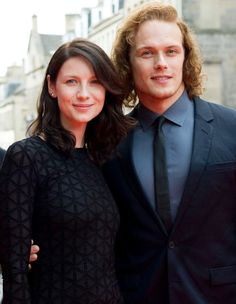 Outlander Starz Behind-the scenes: Catriona Balfe (Claire Randall Fraser) and Sam Heughan (Jamie Fraser)