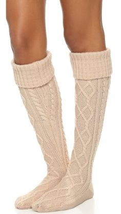 Free People Cozy Cable Over the Knee Socks. Over-the-knee Free People socks in a soft cable knit.