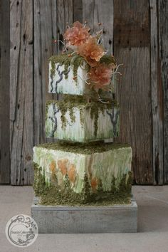 square edible moss covered cake with isomalt sugar glass fantasy flowers