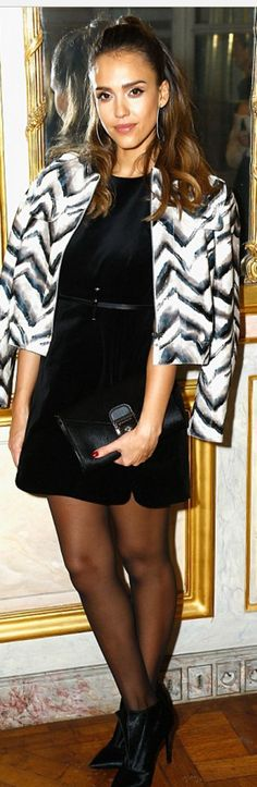 Who made  Jessica Alba's black dress, gray jacket, tights, and clutch handbag?