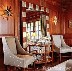 Club chairs upholstered in a pretty gray print sparkle agains the wood-paneled walls. - Traditional Home ® / Photo: Gordon Beall / Design: Joseph A. Keenan