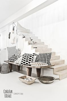 African baskets from Zululand (floor, far left) | African woven grass trays (right) on Senufo ceremonial bed. Styled for Couleur Locale, concept store in Belgium. Baskets from www.designafrika.co.za