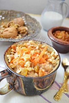 Carrot Cake Oatmeal.  1 cup old fashioned oatmeal    2 cups milk (coconut milk  would work too)    1 tablespoon honey (brown sugar or maple syrup)    1 1/4 cups shredded carrots (1 large carrot)    1/4 cup raisins    1 teaspoon cinnamon    1/4 teaspoon cardamom    To serve:  shredded carrots  chopped walnuts
