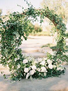 Ceremony round circular arch with smilax & white flowers - Wedding Arch Wedding Arch Greenery, White Wedding Flowers, Wedding Ceremony Decorations, Wedding Centerpieces, Floral Wedding, White Flowers, March Wedding Flowers, Wedding Arches, Cottage Wedding